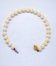 Γυναικείο Βραχιόλι Pearl Κίτρινο Χρυσό 14Κ. Βραχιόλι από κίτρινο χρυσό 14 καράτια με πέτρες μαργαριτάρια.