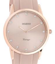 Γυναικείο ρολόι ΟΟΖΟΟ με ροζ χρώμα καντράν και με ροζ χρώμα λουράκι. Η διάμετρος της κάσας είναι 38mm και είναι κατασκευασμένη από μέταλλο.